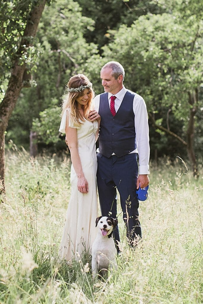 bride and groom portrait with their dog at hall farm weddings wordwell suffolk