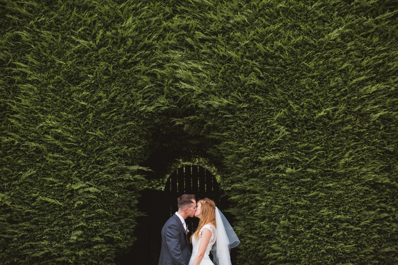 gaynes park bride and groom portraits in the grounds